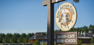 The sign for King Arthur Flour's bakery, cafe, store and school.