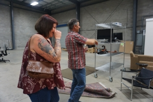Nicole and Dan laughing and looking at the inside of our new warehouse for our coffee roaster in Florida.