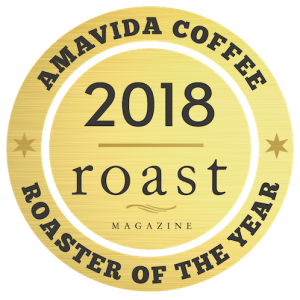 Gold emblem awarded to Roast magazine's 2018 Roaster of the Year, Amavida Coffee Roasters.