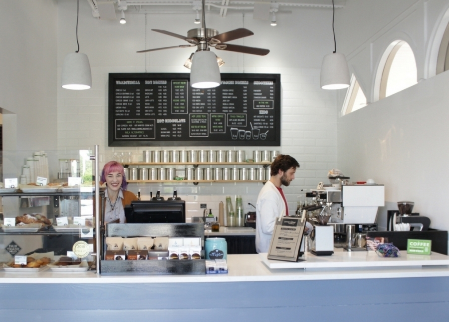 Brewing local specialty coffee at The Market Shops in Miramar Beach, FL. Cafe location with outdoor seating.