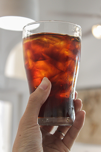 Best Iced Coffee in hand by Amavida Coffee Roasters at The Market Shops in Miramar Beach, FL