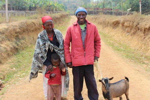 Empowered coffee farming family in Burundi with their goat.