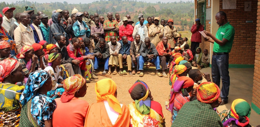 Sustainable Coffee Review Top Score 90 Points. Photo of Village meeting.