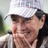 Woman farmer from the COMSA Cooperative smiles over Honduras single origin coffee.