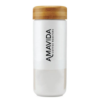 Ceramic travel mug with lid by SOMA and custom printed Amavida Coffee Roasters logo.