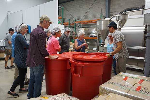 People visit coffee roastery in Florida for monthly tour. See barrels of organic coffee and our Loring roaster in action.