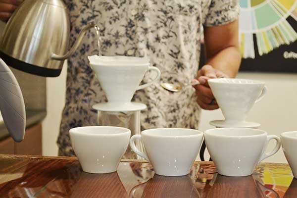 Tasting three different pour over coffees after the coffee roaster tour at Amavida Coffee.