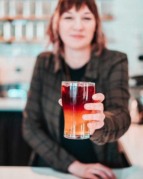 "Kristin Spargo, barista at Amavida Coffee Roasters, seen holding her herbal iced tea ""The Bubbleyum Spring"""