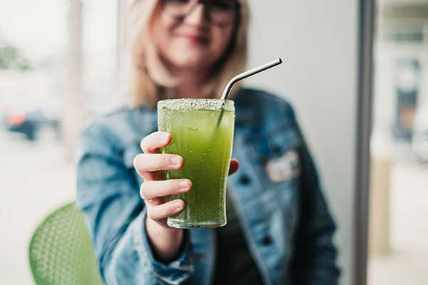 Aleighsa Wright, barista at Amavida Coffee Roasters, seen here holding her iced matcha tea limeade.