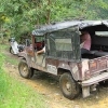An old jeep driving through remote coffee lands delivering Edith Yasso's Colombian microlot to be imported and roasted by B Corp coffee companies