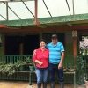 Colombian Coffee Producers and Winners of the 2005 Cup of Ecxellence Edith Enciso Yasso (left) and her husband, Wilson (right) standing together