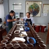Two people cupping high quality Peru Gesha and other fair trade, organic certified coffees from the Sol y Café Cooperative.