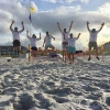 South Walton Turtle Watch volunteers jumping for joy on the beaches of South Walton County, Florida in after finding a sea turtle nest.